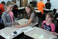 NAMS students work together on the weekly STEAM Challenge