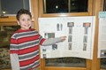 Franklin student with his Science Fair project