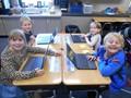 Second graders using Chromebooks