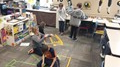 Penn students making geometric shapes on the floor