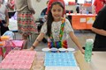 A NAMS student with her Probability Carnival game