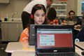 Students use a Chromebook to participate in the Future Hockey Scholars Program