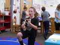 Students have fun launching items from the catapults they made