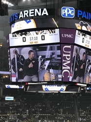 Mr. Fisher on the Zamboni at the Penguins game