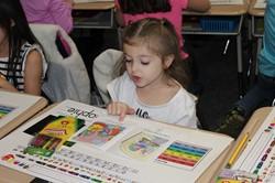 Memorial kindergarten students read with Miss A