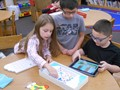 Students use Puzzlets to participate in Hour of Code activities