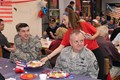 IMS students serve breakfast to the Veterans