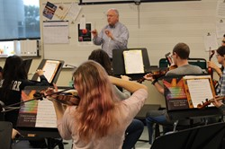 Dr. Davidson conducts the BPHS String Orchestra