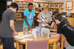 IMS students sample books at a Book Tasting Event