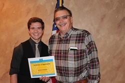 Greydon Tomkowitz and Rotary President Gary Lee