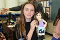 A NAMS student with her sculpture
