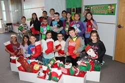 Memorial Fourth Graders with the filled Christmas stockings