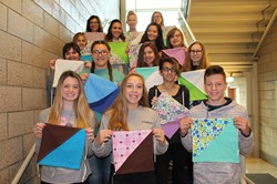 Ms. Potts' sewing students with some of the blankets they made
