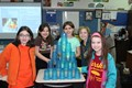 Students build a pyramid without using their hands