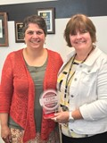 BP Assistant to the Superintendent Janet O'Rourke accepts the Carnegie STEAM Pathway Partner Award