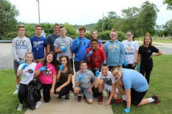 IMS students work to clean up the area around the Administration Building.