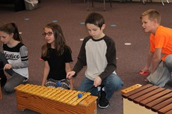 Lincoln students playing xylophones