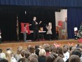Students helping at the anti-bullying Magic Assembly