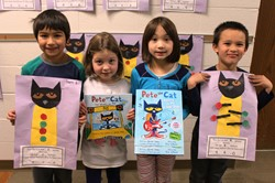 Washington First Graders with Pete the Cat books and math problems