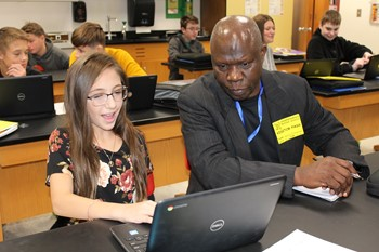 Student showing her web page to one of the African visitors