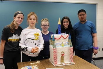 Five students with their gingerbread house