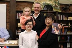 Mr. Johnson, his two children and School Board Vice President Connie Ruhl