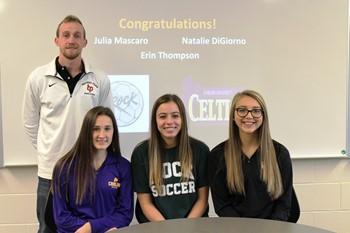 The three soccer scholarship athletes and Coach Hueler