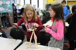 Two students with their structure
