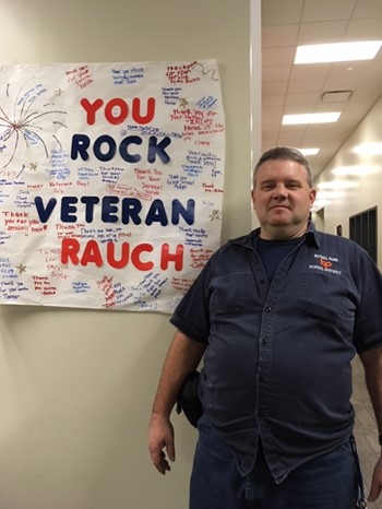 Mr. Rauch and the poster the students made for him