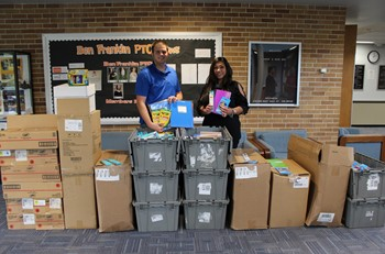 Office Depot Manager Rich Davis and Franklin Principal Mrs. Doumont stand behind all of the school supplies
