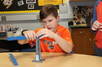 Student working with a lever