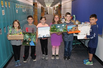 Six students with their habitat dioramas