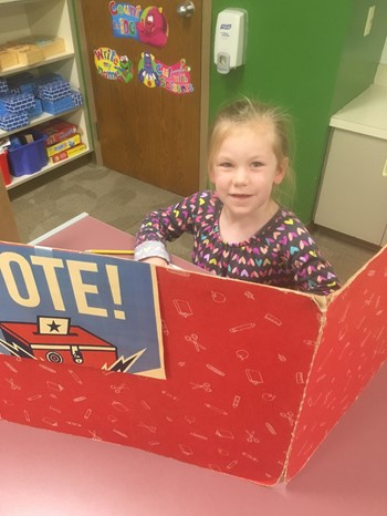 Student casting her vote