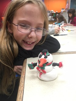 Memorial student with her snowman