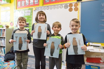 Students with their paper groundhogs