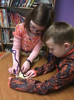 Students making a mini snowboard