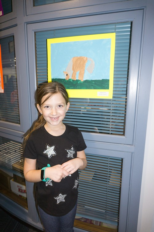 Student at with her artwork