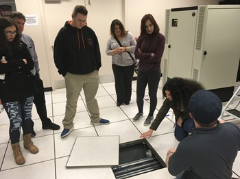Looking under the floor tiles in the Supercomputer Center's server room