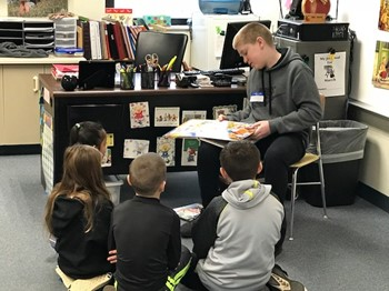 IMS student reading to Lincoln students