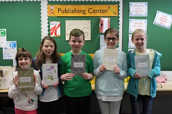 Five students with their books in the Lincoln Publishing Center