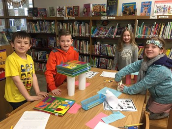Students with their book tower