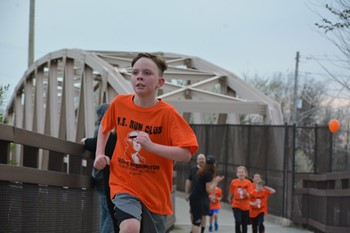 Students running on the Montour Trail