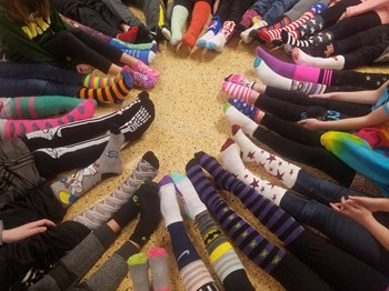 students showing off their socks in a circle