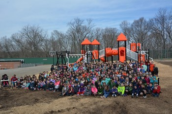 Washington students in front of their new playground equipment
