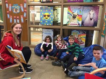 IMS student reading to Washington students