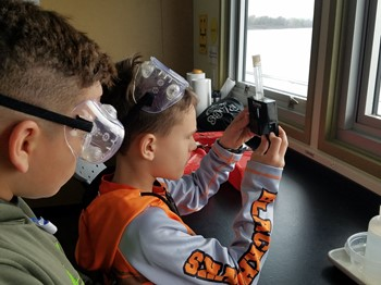 Two students working on an experiment