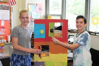 Two students with their game