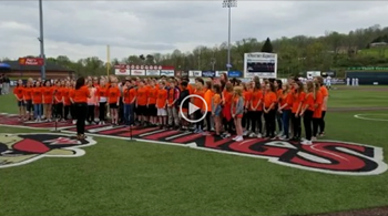 NAMS Chorus singing the National Anthem