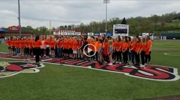 NAMS Chorus singing the National Anthem