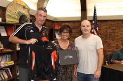 Mrs. Cook and two members of the Bethel Park Soccer Boosters Executive Board
